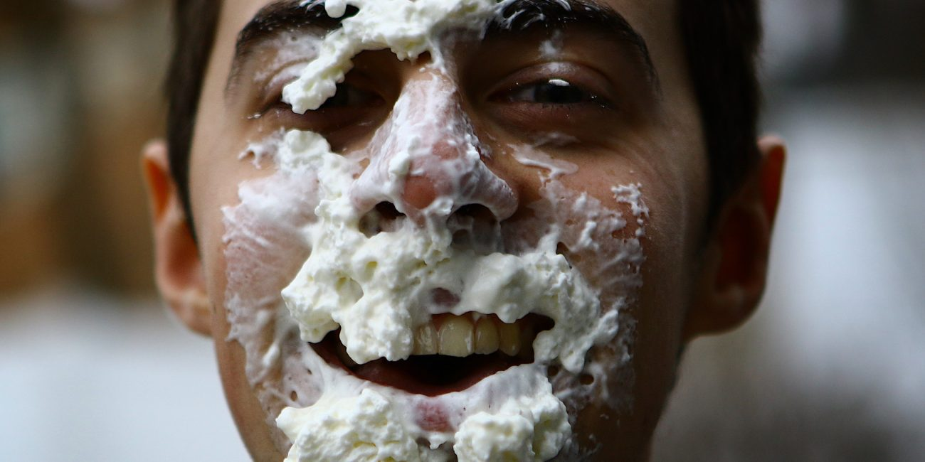 """Andrew Belliveau, who has Gastoparamesis, is seeking to gain awareness and fund-raise for a cure, shown here with whip cream on his face, he has begun a """"pie-in-the-face"""" challenge."""