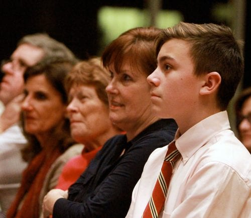 Jonathan Heins, 13, listens during a Norma Marks Shribman Memorial Town Hall gathering at Temple Emanu-El in Marblehead. He is the grandson of panelist, Michael Harrington.