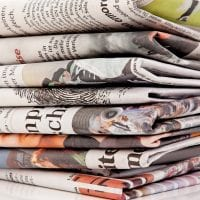 photo of stacked newspapers