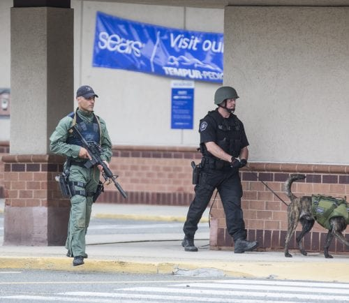 Members of NEMLEC SWAT search the area around the Square One Mall where it was reported that a man with a gun was inside in Saugus on Monday, June 19, 2017. (Scott Eisen/The Item)