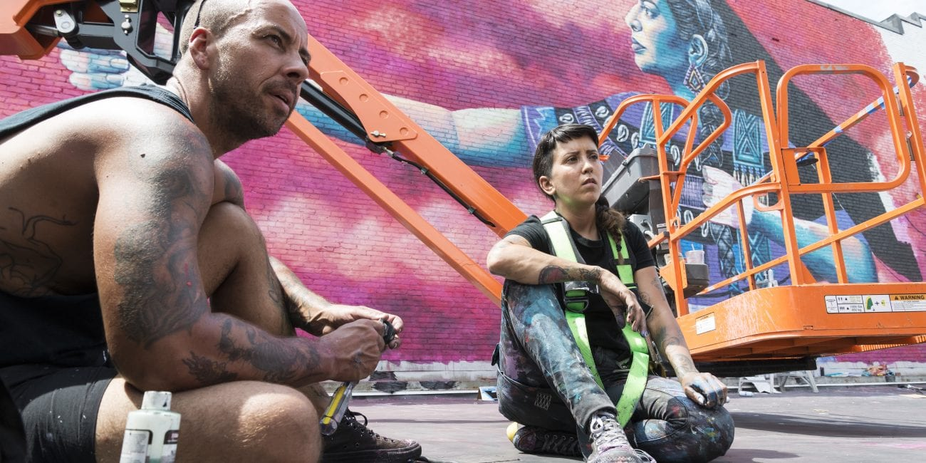 Artists Chuck Berrett and Nicole Salgar speak about the inspiration behind the Wampanoag woman they chose as the centerpiece for their mural.