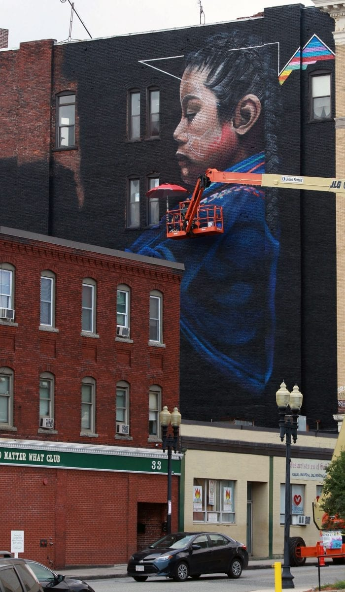 At right, a mural painted on the building at the corner of Spring and Exchange streets by Mexican-born and New York City-based artist Marka27.