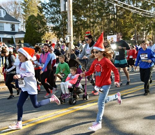 Hundreds of families and friends participated in the fifth annual Jingle Bell 5K Run/Walk on November 25 to raise money for Medford schools.