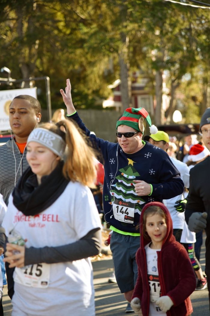 John Finn waved to friends and family as he began the fifth annual Jingle Bell 5K Run/Walk on November 25 to raise money for Medford schools.