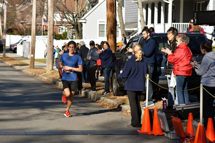 Sean Kay, an Arlington Catholic High School sophomore, came in first place at 17:21 at the fifth annual Jingle Bell 5K Run/Walk on November 25 to raise money for Medford schools.
