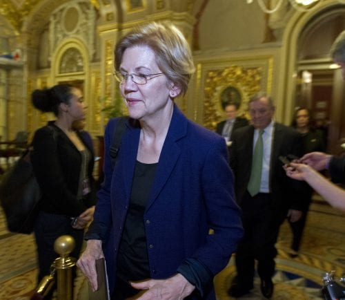 Sen. Elizabeth Warren, D-Mass., walks to the chamber after a closed meeting with democrats, on Capitol Hill, Friday, Jan. 19, 2018, in Washington. ( AP Photo/Jose Luis Magana)