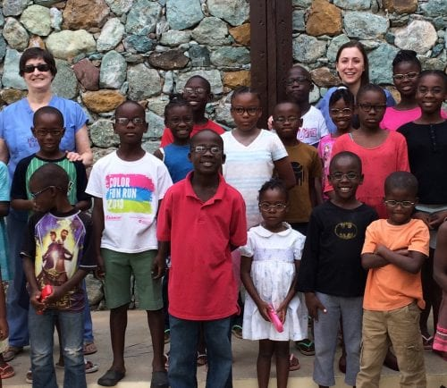 Julie and Vicki Kvedar with 21 children at Be Like Brit orphanage in Haiti.