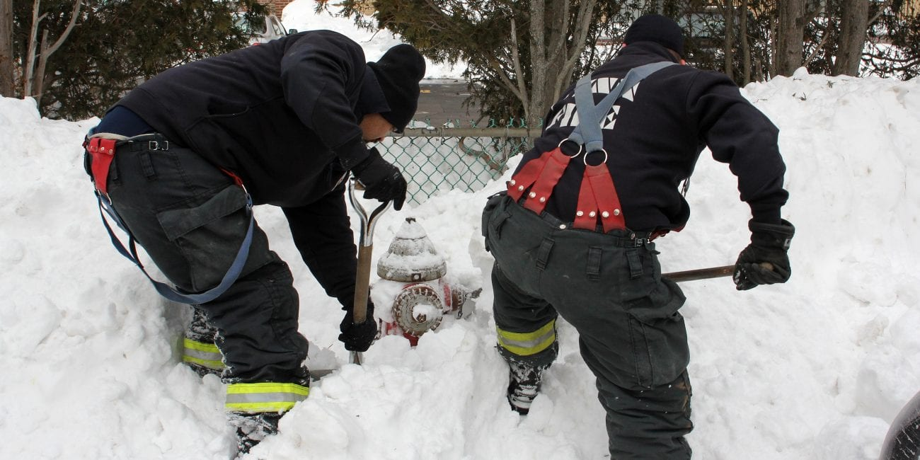 Lynn, Ma. 1-8-18. Lynn fire fighter Robert Kimber, left, and Lynn fire fighter Christopher Doucette, right, shovel out one of the thousands of fire hydrants in Lynn.