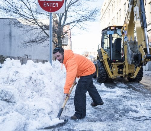 Lynn Water and Sewer Commission employee Justin Candilieri went around to storm drains on Washington Street in Lynn on Wednesday to clear them of snow and ice in preparation of the warm weather and heavy rain predicted for the weekend.