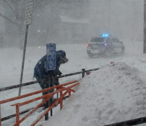 Heavy winds and snow caused near white-out conditions in Peabody near noon as most traffic was off the streets except for plows and police.