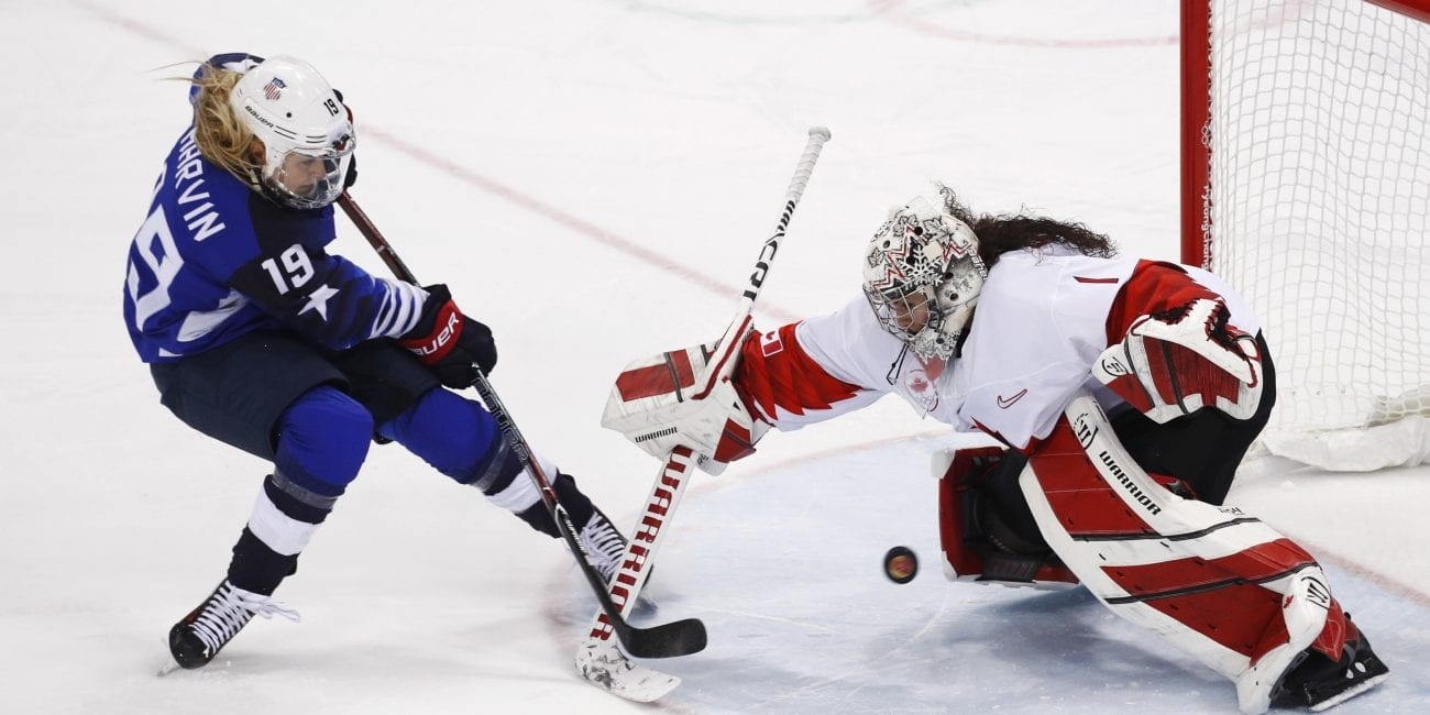 Gigi Marvin (19), of the United States, scores a goal against goalie Shannon Szabados (1), of Canada, in the penalty shootout during the women's gold medal hockey game at the 2018 Winter Olympics in Gangneung, South Korea, Thursday, Feb. 22, 2018.