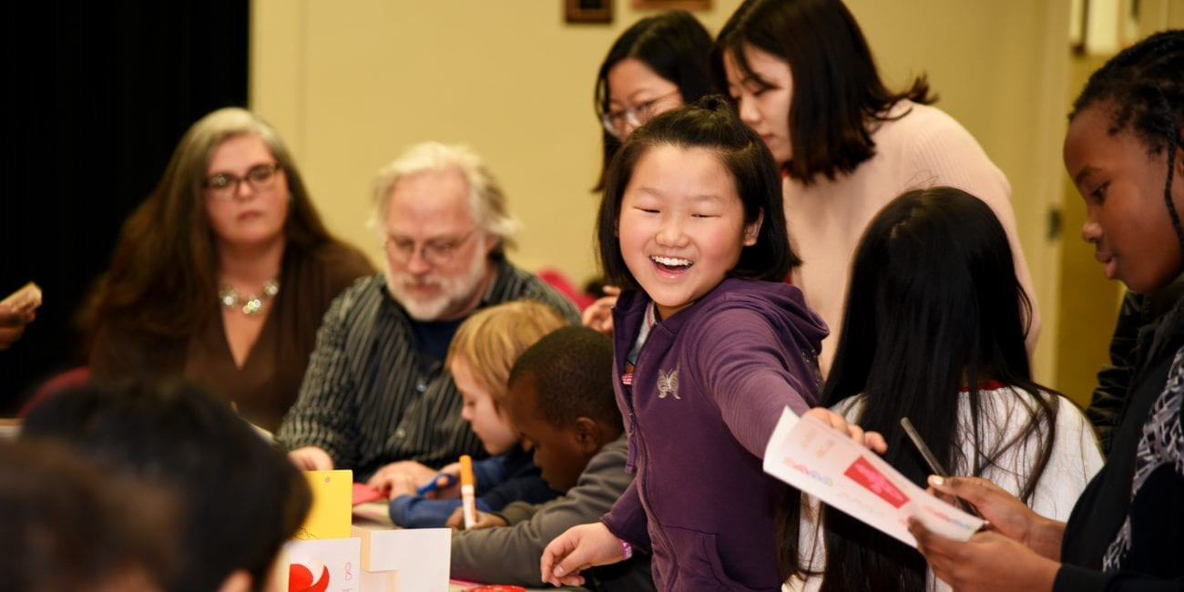 Catherine Xu having fun with friends during the February 15th Chinese New Year Celebration at the Medford Public Library.