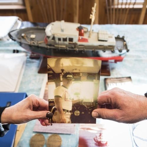 Maureen Quirk Ouellette and Frank Quirk III hold a photo of their father, Frank Quirk Jr., who died after rescuing a Coast Guard crew during the Blizzard of '78.
