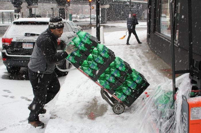 Lynn, Ma. 2-7-18. Manny Parrill delivers soda to Domino's Pizza on Union Street.