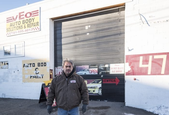 vEo Autobody Solutions & Repair Llc., Manager Alfredo Chavez stands in front of his shop on Bennett Street in Lynn.
