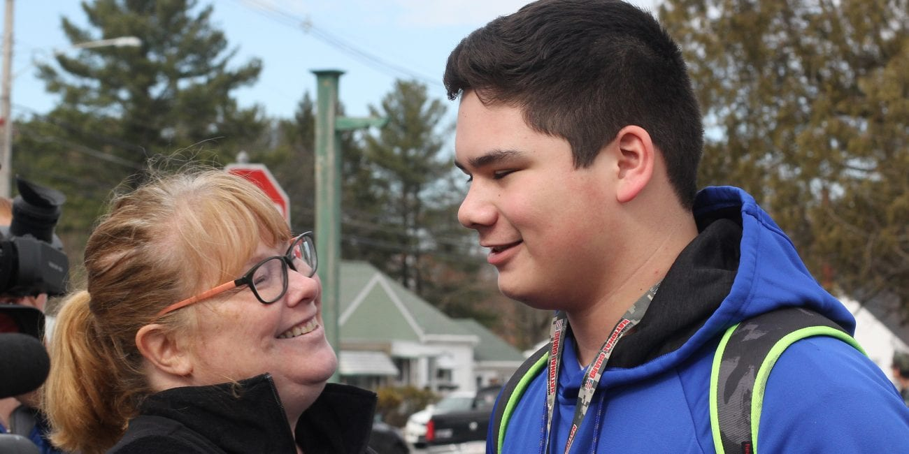 Tracy Siose and her son Christian reunite after the lockdown at Northeast Metropolitan Regional Vocational Technical High School.