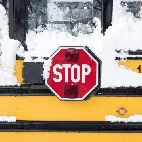 A Lynn school bus waits to be cleared of snow following the storm on Wednesday.