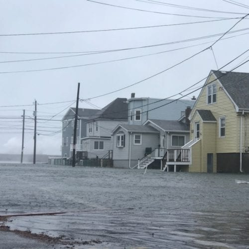 Pearl Street in Revere was underwater as the ocean crashed over the sea wall during high tide Friday morning.