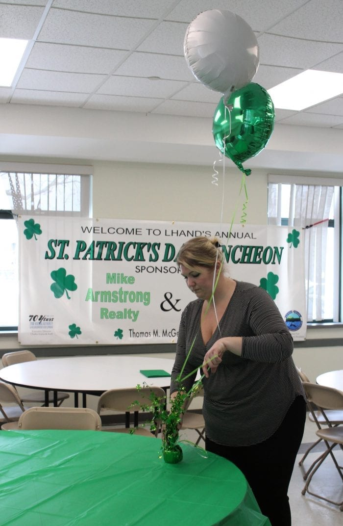 Lynn, Ma. 3-14-18. Cathy Rowe prepares the room at the Lynn Housing Authority & Neighborhood Development room for tomorrow's St. Patrick's Day lunch.