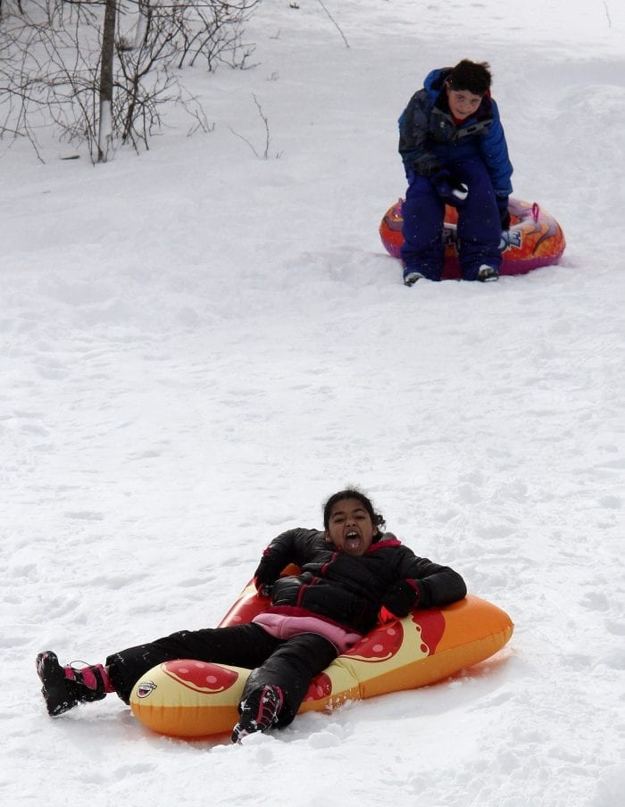 Lynn, Ma. 3-14-18. Jared Thomas and Gianna Fortes sledding at Gannon Golf Course in Lynn.