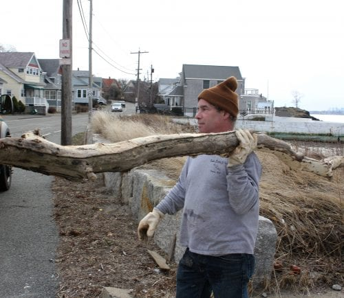 Nahant, Ma 3-1-18 Dan Gauvain, Nahant DPW, removes driftwood from a beach in Nahant before the storm throws it through the window of a house.