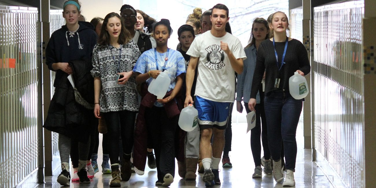 Swampscott, Ma. 3-22-18. Chrissy Rogers, Marley Schmidt, Mahder Teferra, Reece Klusza, and Mariel Flughum walk for water around the halls of Swampscott High School on World Water Day.