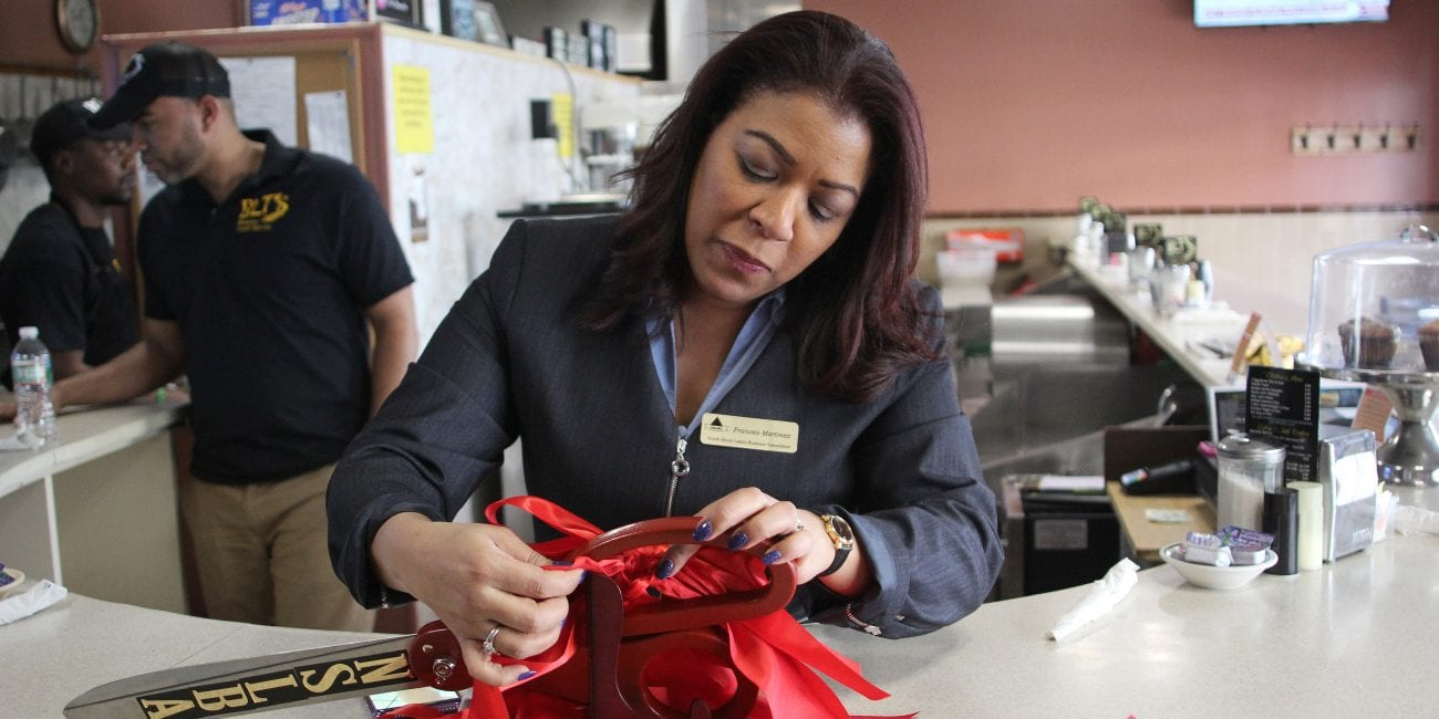 """Lynn, Ma. 4-2-18. Frances Martinez, of the North Shore Latino Business Association, prepares for the grand reopening of BLT""""s restaurant on Broad Street in Lynn."""