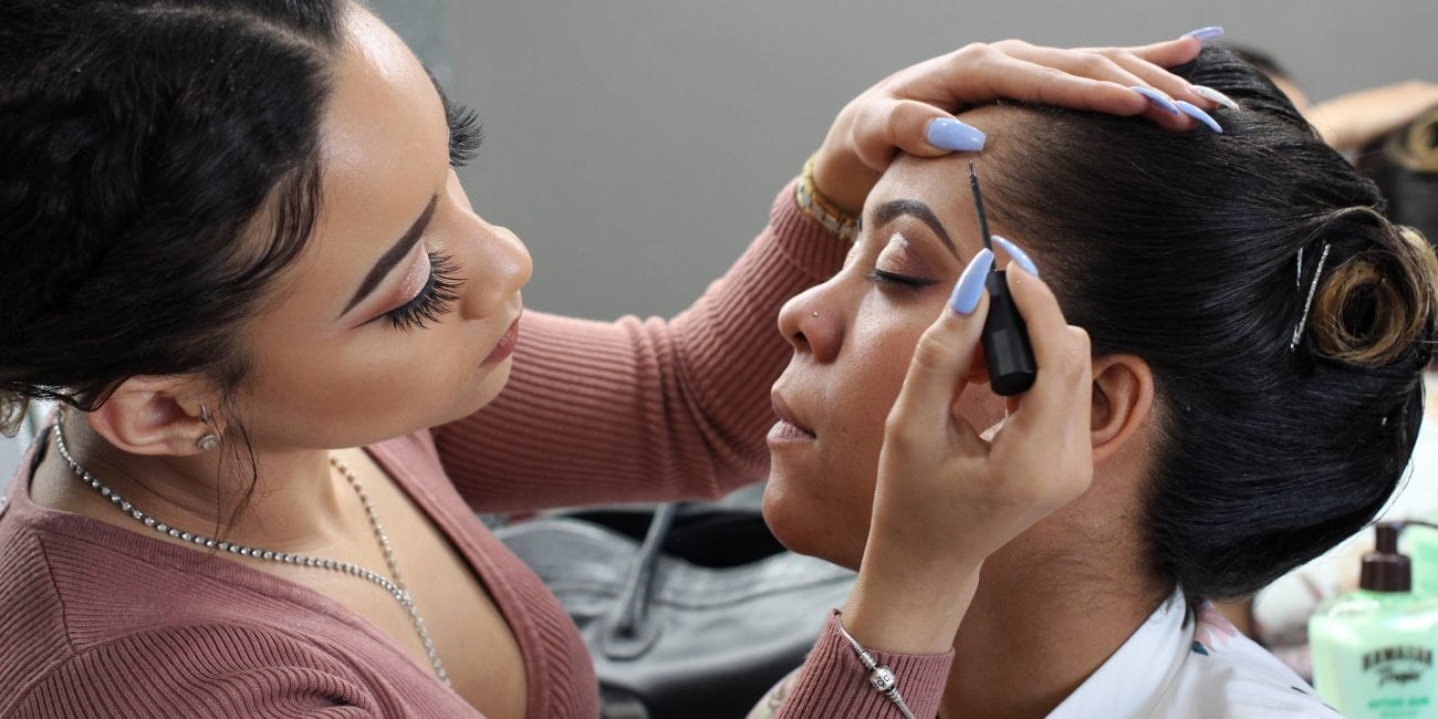 Lynn, Ma. 4-9-18. Genesis Grullon makes up Karina Diaz at Slay n Glam in Lynn.