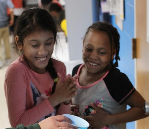 Lynn, Ma. 4-26-18. Aaliyah Grullard, left, and Kayla Corley, right with their science project Ancient Civilization water wheel at the science fair held at the Lynn YMCA.