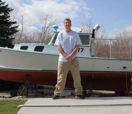 Nahant, Ma. 4-11-18. Justin Mahoney is a write-in candidate for selectman in Nahant. Behind him is the boat he uses to fish for lobsters.
