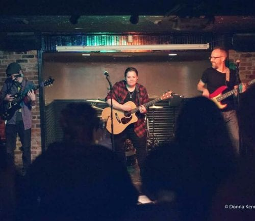 Jme Redd, center, performs with guitarist Peter Davis (left) and bassist Christopher Stone at O'Brien's in Lynn.