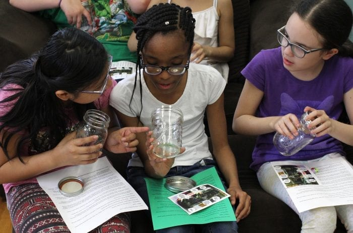 Lynn, Ma. 5-3-18. Hailley Mendez, left, Laisha Mercedes, and Jasmin Guzman look at their jars which they will use to build a salad at Girl's Inc.