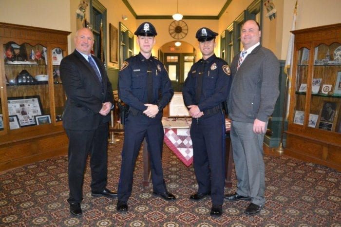 Town Manager Scott C. Crabtree (right) announced the appointment of Officers Zelinski (second left) and Defreitas (second right) as Saugus Police Officers. They are joined by Saugus Police Chief Domenic DiMella (left).