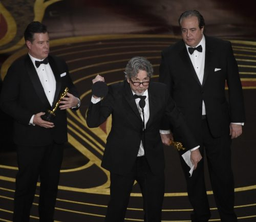 "From left; Brian Hayes Currie, Peter Farrelly and Nick Vallelonga accept the award for best original screenplay for ""Green Book"" at the Oscars on Sunday at the Dolby Theatre in Los Angeles."