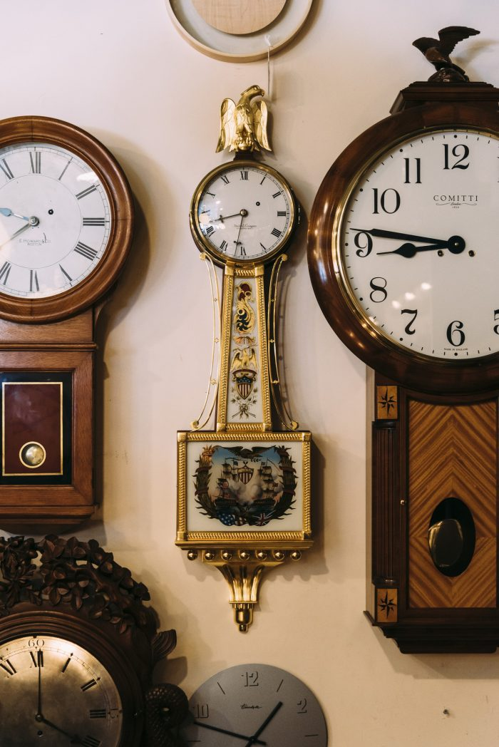 A banjo clock, center, is the feature piece on back wall of Phillips' Clock Shop.