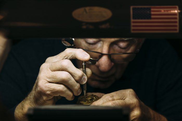 George Phillips works on a pocket watch in his shop, Phillips' Clock Shop.