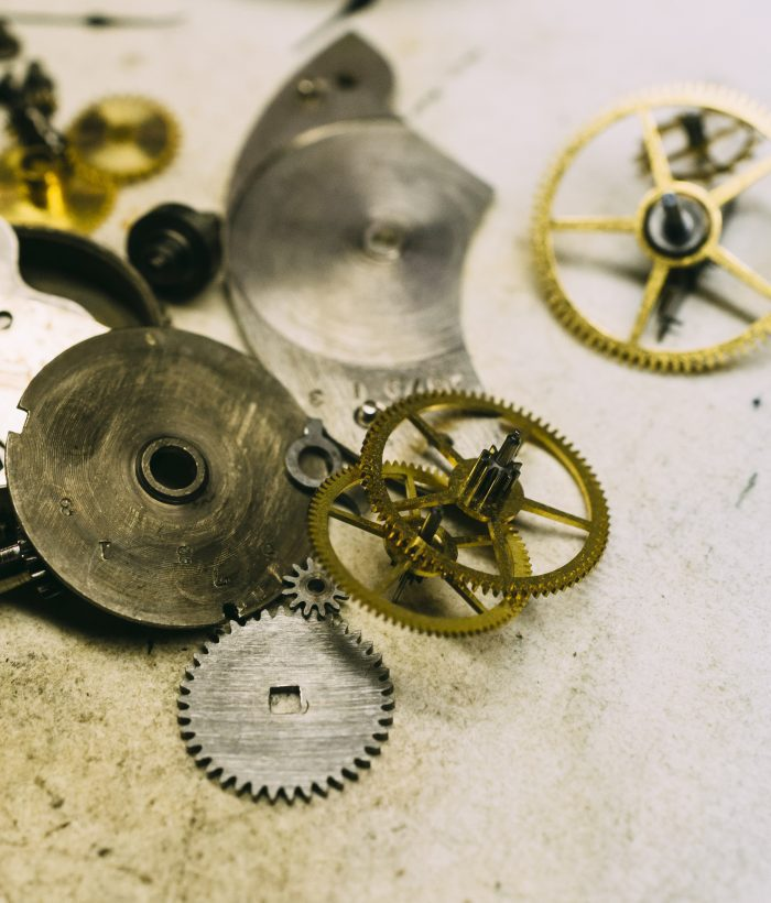 The inner workings of a disassembled pocket watch.