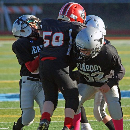 Peabody and Salem youth football players going head to head.