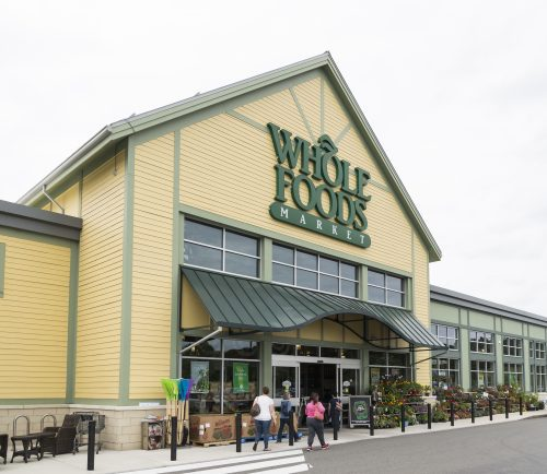 Customers walk into Whole Foods at MarketStreet in Lynnfield on Friday.
