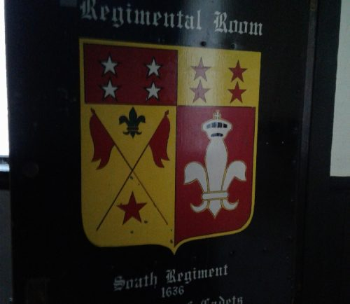 A door in the Lynn Armory displays the lineage of National Guard units based in the South Common Street facility.
