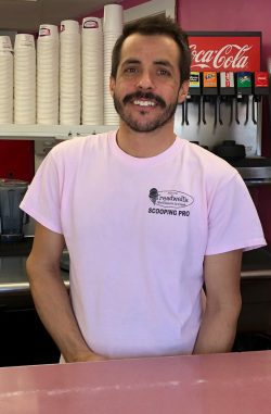 Mike Gould, behind the counter at Treadwells Ice Cream in Peabody.