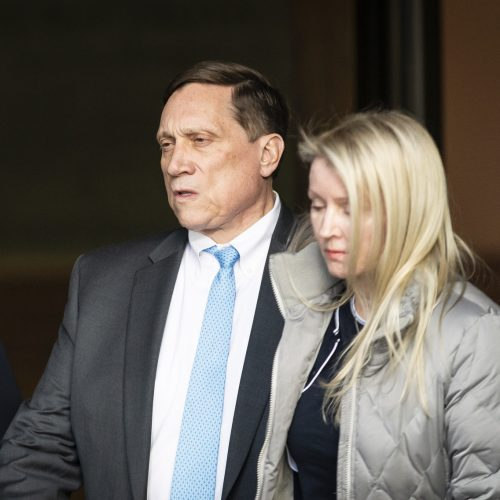 John Wilson and is wife Leslie the John Joseph Moakley U.S. Courthouse following a hearing in Boston on Wednesday.