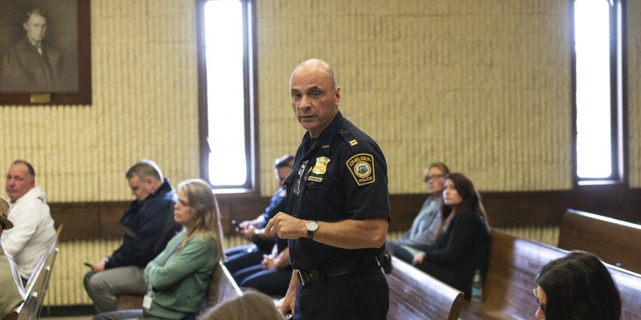 Chelsea Police Captain Dave Batchelor teaches the crowd gathered in Courtroom 2 of Lynn District Court about the Hub model on Wednesday.