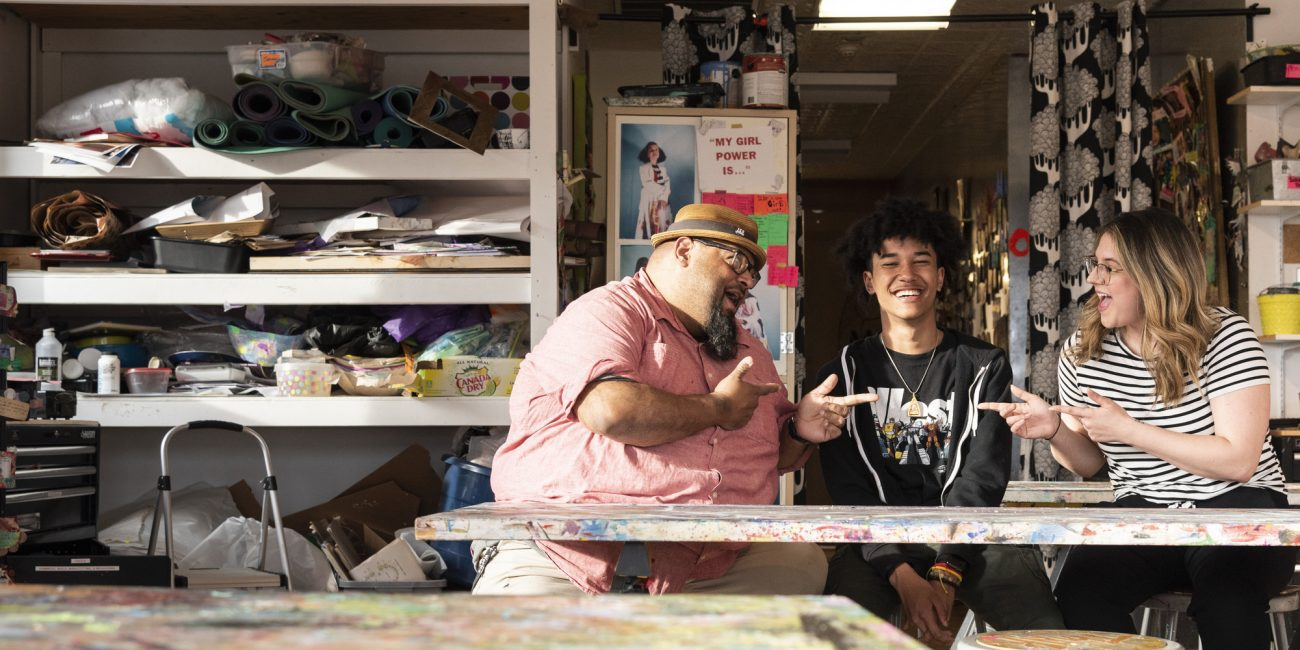 Jason Cruz, left, and Kaitlyn Farmer have been mentoring De'Andre Hardy at Raw Art Works since he first joined at age 6.