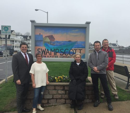 For the last five years, a Welcome to Swampscott sign has been absent. Selectman Don Hause, Jackie Kinney, of ReachArts, Anita Balliro, artist and former high school art teacher, Bruce Paradise, of Paradise Construction, and David Shear, of ReachArts unveiled the new sign Wednesday morning.
