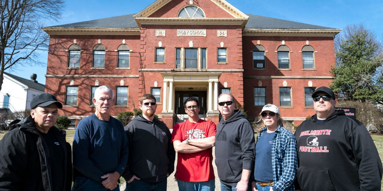Saugus school custodians including, from left, Carlos Gonzalez, John McBride, Tom Lowe, Steve Raso, Rick Nelson, Angela McGeorge and Michael Mabee might lose their jobs if the town decides to privatize custodial services.