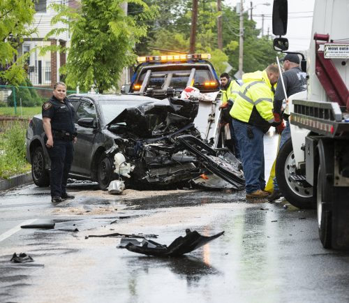 First responders and crews work to clean up a head-on collision between a tow truck and sedan on Lincoln Avenue in Saugus Tuesday afternoon.
