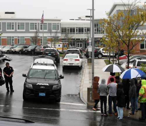 Main entrance to KIPP Academy Lynn Charter School on High Rock Street during a lockdown due to a report that a student had a gun on campus. Parents (right) were kept away from the school while police conducted a search of the building